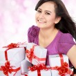 Stock Photo: Happy teenager bring some gift