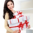 Smiling girl with a gift boxes — Stock Photo