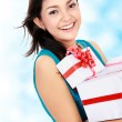 Smiling girl with gift boxes — Stockfoto #20562069