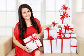 Beautiful girl with a gift boxes — Stock Photo