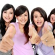 Group of beautiful women showing thumbs up — Stock Photo