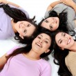 Teenage girls lying on white floor — Stock Photo #21235277
