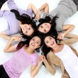 Teenage girls lying on white floor — Stock Photo