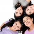 Stock Photo: Teenage girls lying on white floor