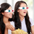 Group of girls watching the movie - Stock Photo