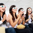 Постер, плакат: Group of girls watching good 3D movie