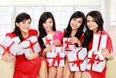 Woman group with many gift boxes — Стоковое фото