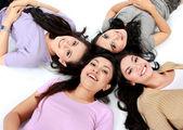 Teenage girls lying on white floor — Stock Photo