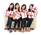 Woman group holding gift boxes — Stock Photo