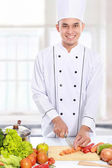 Male chef preparing some food — Stock Photo
