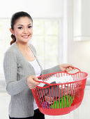 Woman with a basket of loundry — Stock Photo