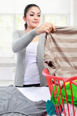Woman having laundry at home — Stock Photo