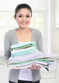 Smiling woman with laundry — Stock Photo