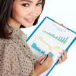 Happy businesswoman with annual report — Stock Photo