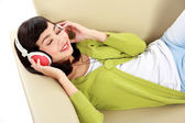 Young girl listening to music — Stok fotoğraf