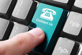 Contact us button on the keyboard — Stock Photo