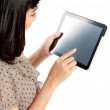 Businesswoman standing with touch pad — Stock Photo