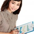A successful young woman smiling and holding a clipboard — Stock Photo