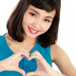 Heart shaped by the hands of a beautiful young women — Stock Photo