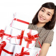 Stock Photo: Young happy woman with gift box