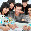 Friendly group of students with tablet pc — Stock Photo #27112591
