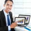 Business man showing tablet pc — Stock Photo