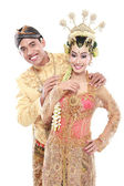 Happy traditional java wedding couple husband and wife embrace e — Stock Photo