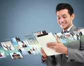 Business man with tablet — Stock Photo