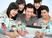 Friendly group of students with tablet pc — Stock Photo