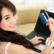 Young woman doing online shopping — Stock Photo