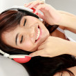 Stock Photo: Young girl listening the music