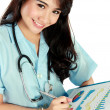Young nurse smiling while working — Foto de Stock