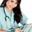 Young nurse smiling while working — Stock Photo