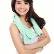 Smiling happy asian woman fitness model with arms crossed — Stock Photo #27556541