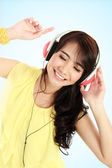 Happy Young asian girl with headphones — Stock Photo