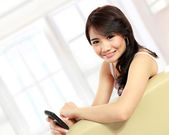 Young beauty girl with handphone — Foto Stock