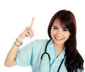 Mutlu genç hemşire stetoskop ve düşünme — Stok fotoğraf
