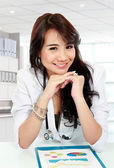 Smiling young asian female doctor — Stock Photo