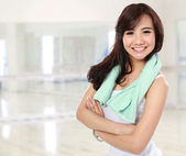 Smiling happy female fitness with arms crossed — Stock Photo