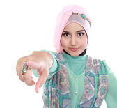 Beautiful young muslim woman pointing — Stock Photo