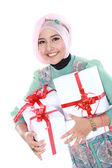Happy young muslim woman with gift boxes — Stock Photo