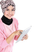 Beautiful young muslim woman holding tablet computer — Stockfoto
