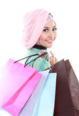 Closed up of beautiful muslim woman holding a few shopping bags — Stock Photo