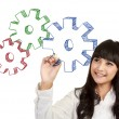 Businesswoman drawing gear cogs — Stock Photo