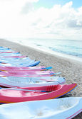 Colorful canoes in the beach — Stock Photo