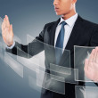 Hand pushing on a touch screen interface — Stock Photo #30705949