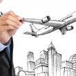Stock Photo: Businessmdrawing business travel concept
