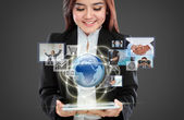 Businesswoman navigating in virtual reality interface — Stock Photo
