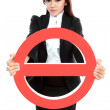 Businesswoman holding prohibited sign — Stock Photo