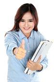 Portret van gelukkig student bedrijf een paar boeken en duimen — Stockfoto